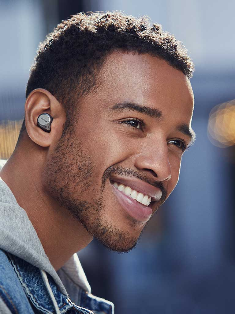 Image of a man wearing the Jabra Elite Active 75t Earbuds