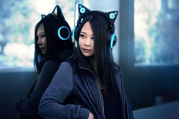 woman wearing cat headphones