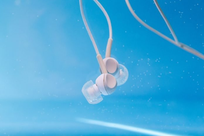 headphones for music in the water. musicfan enjoy the music, the concept. Deep dive. waterproof equipment