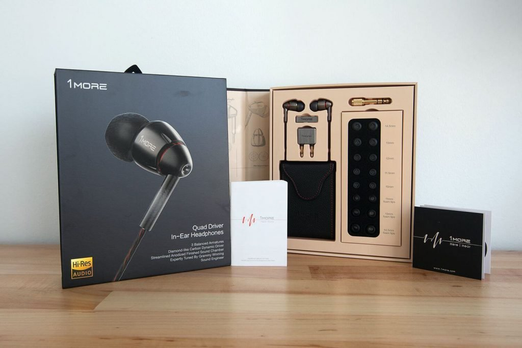 image of the 1More quad driver headphones and boxset on a table