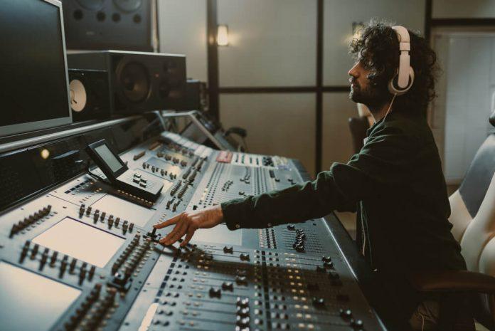 man wearing mixing headphones in the music studio