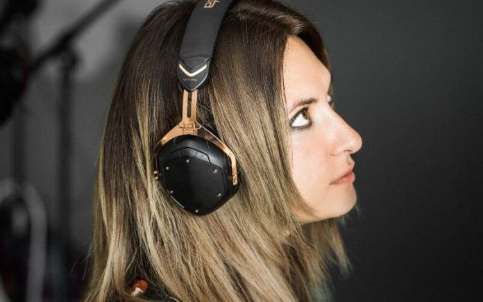 girl wearing black headphones, rock and roll themed headphones